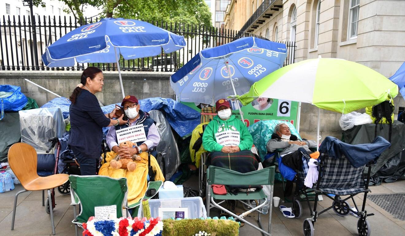 Dhan Gurung, Pushpa Rana Ghale and Gyanraj Rai continue their hunger strike outside 10 Downing Street. Photo: AFP