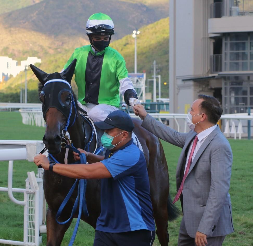 Jockey Joao Moreira and trainer Caspar Fownes celebrate a winner.