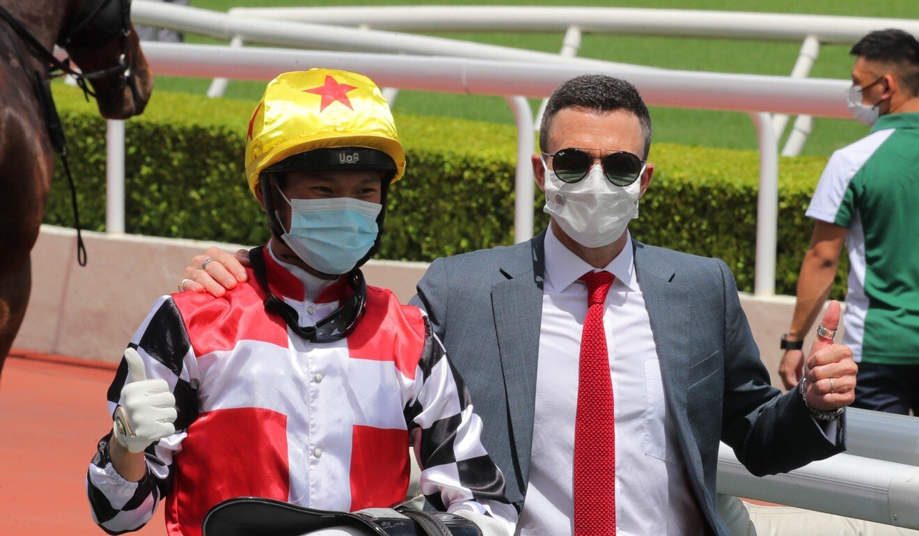 Jockey Jerry Chau and trainer Douglas Whyte celebrate First Responder's victory.