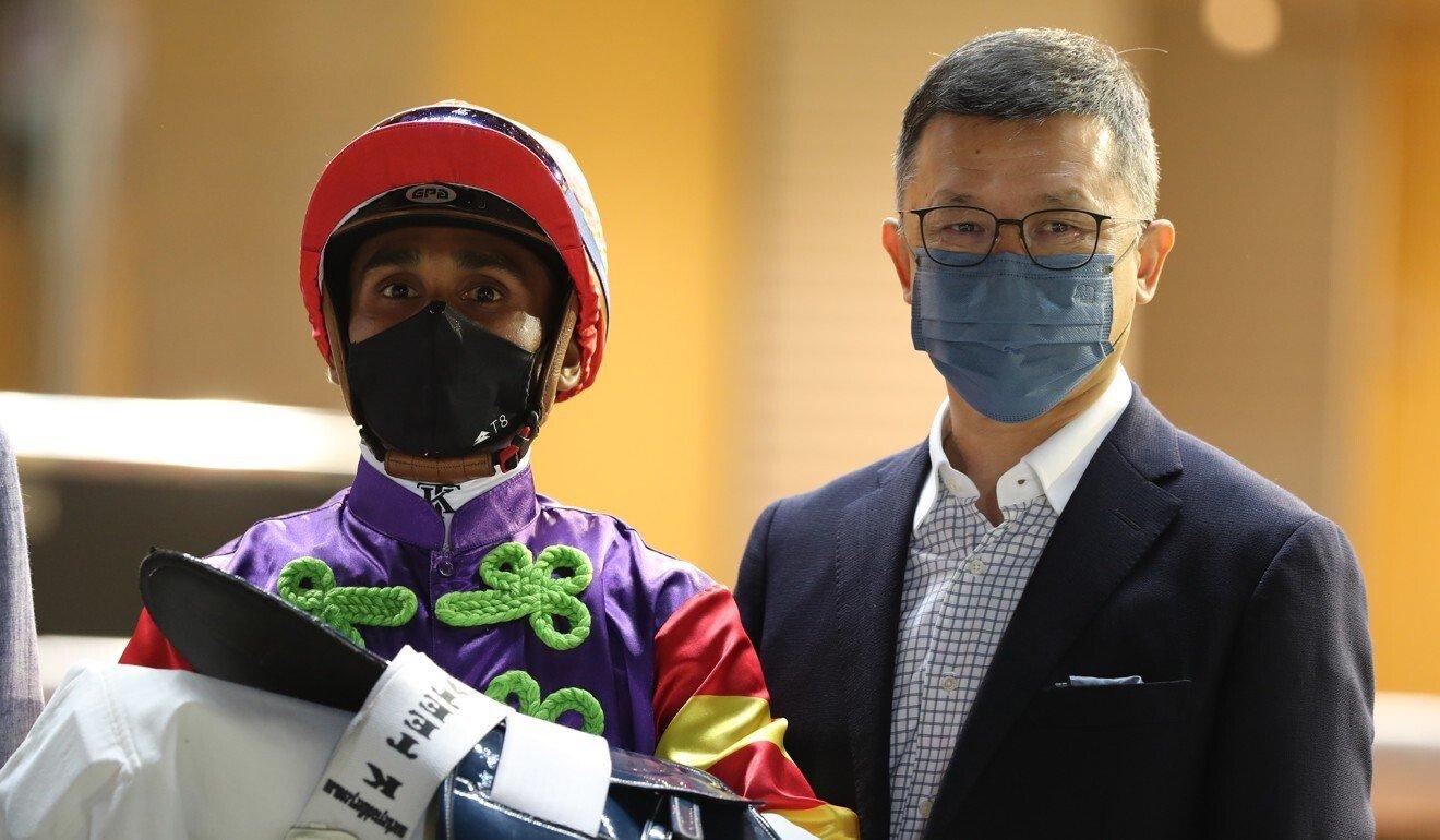 Jockey Karis Teetan and trainer Peter Ho after Wood On Fire's victory.
