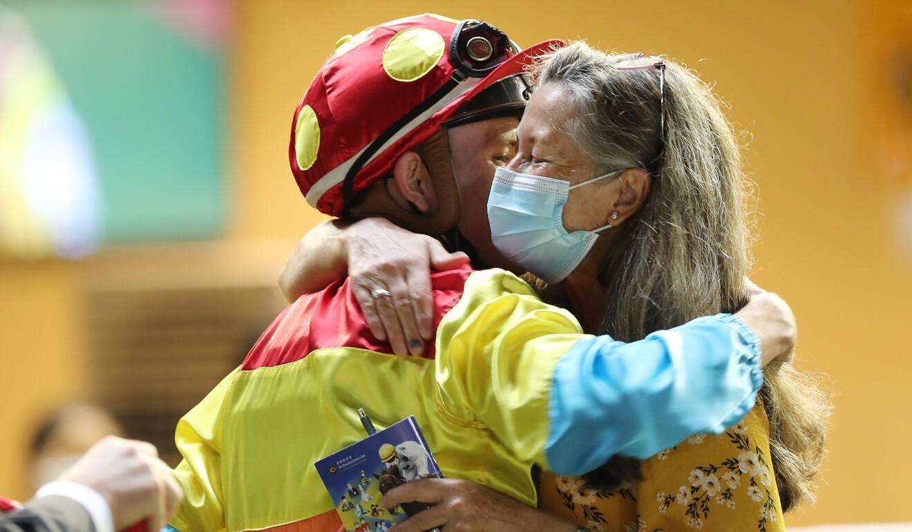 Luke Ferraris hugs mother Pam after his first Hong Kong victory on Wednesday night.