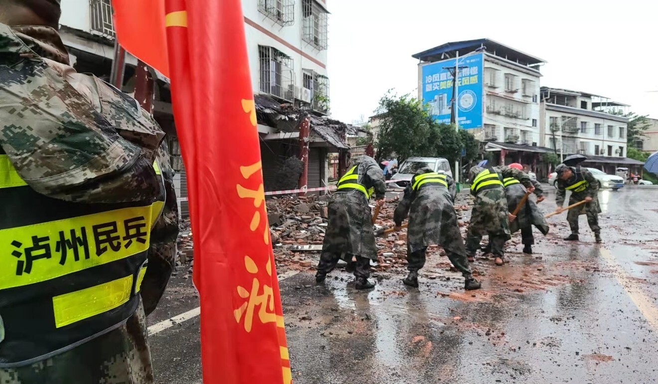 Rescuers remove debris in Fuji, a town in Luxian county which was struck by an earthquake on Thursday. Photo: Xinhua