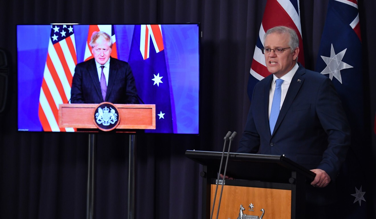 Australian Prime Minister Scott Morrison speaks during a joint press conference via video link with British Prime Minister Boris Johnson (on screen) and US President Joe Biden as they announced a new strategic alliance on Wednesday. Photo: EPA-EFE