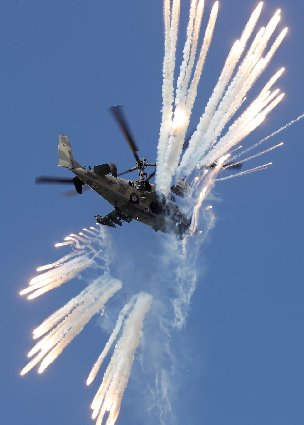 A Russian Ka 52 Alligator reconnaissance and combat helicopter performs during the MAKS 2019 International Aviation and Space Salon in Zhukovsky outside Moscow in 2019. Photo: EPA-EFE