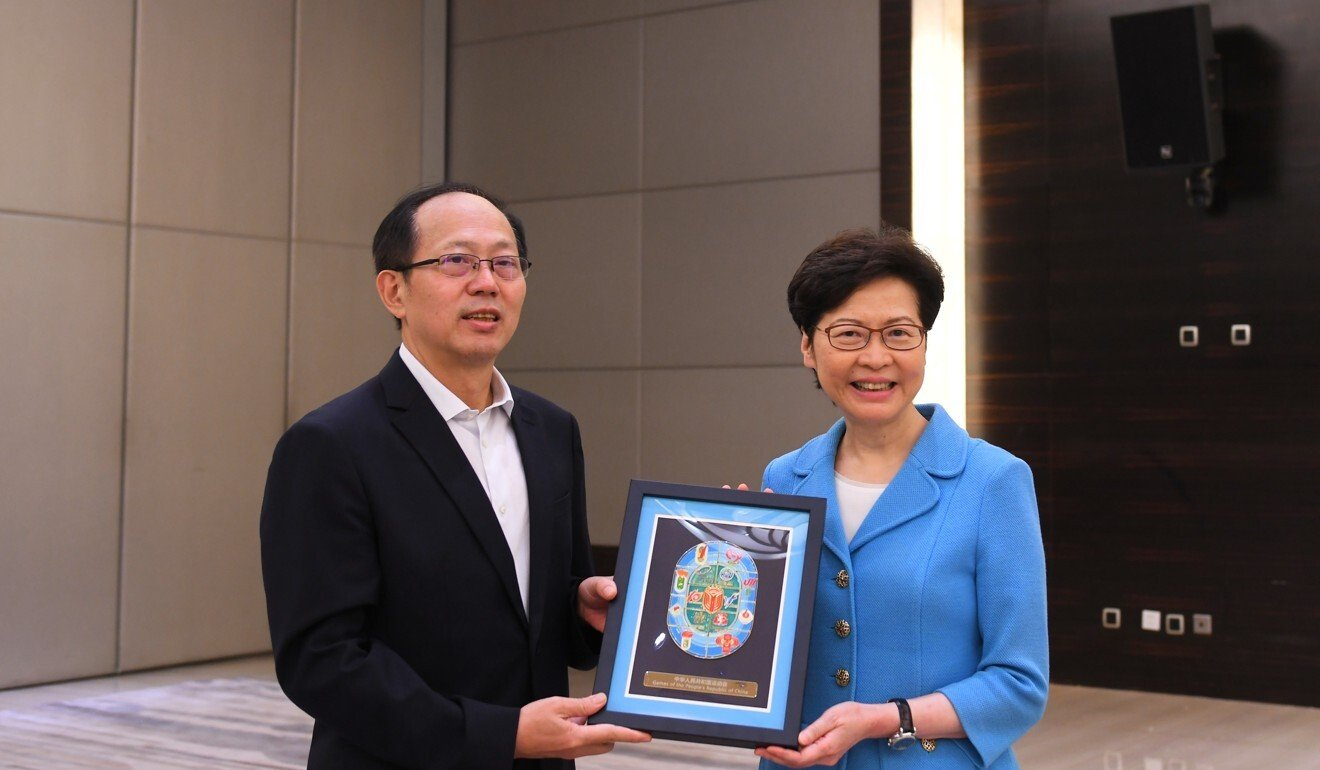 Hong Kong leader Carrie Lam poses with Gou Zhongwen, director of China's General Administration of Sport, on Sunday in Shaanxi province. Photo: Handout