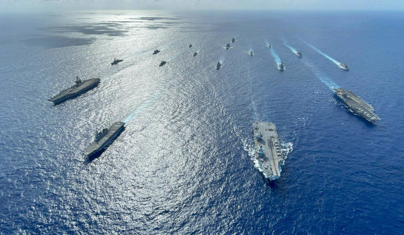Two US and a British carrier pictured with Japanese warships as part of a multinational exercise. Photo: Handout