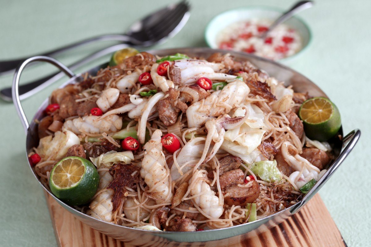 Three classic Filipino recipes that anyone can make, from sizzling sisig to pancit