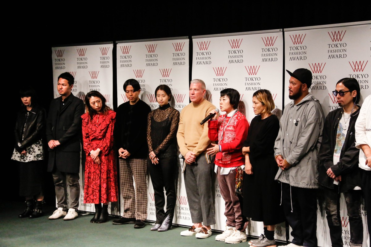 afa49c67f3d Akiko Shinoda (in red sweater) flanked by Nick Wooster (on her right)