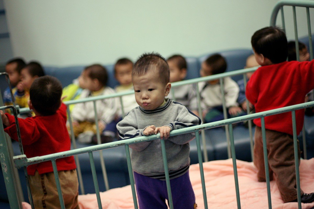 He Yue Ke, 2, stands inside a cot in Shanghai Children's Home orphanage in this 2005 file photo. That year, US adoptions of Chinese children peaked at 7.903; numbers have since fallen by more than 80 per cent. Photo: Reuters