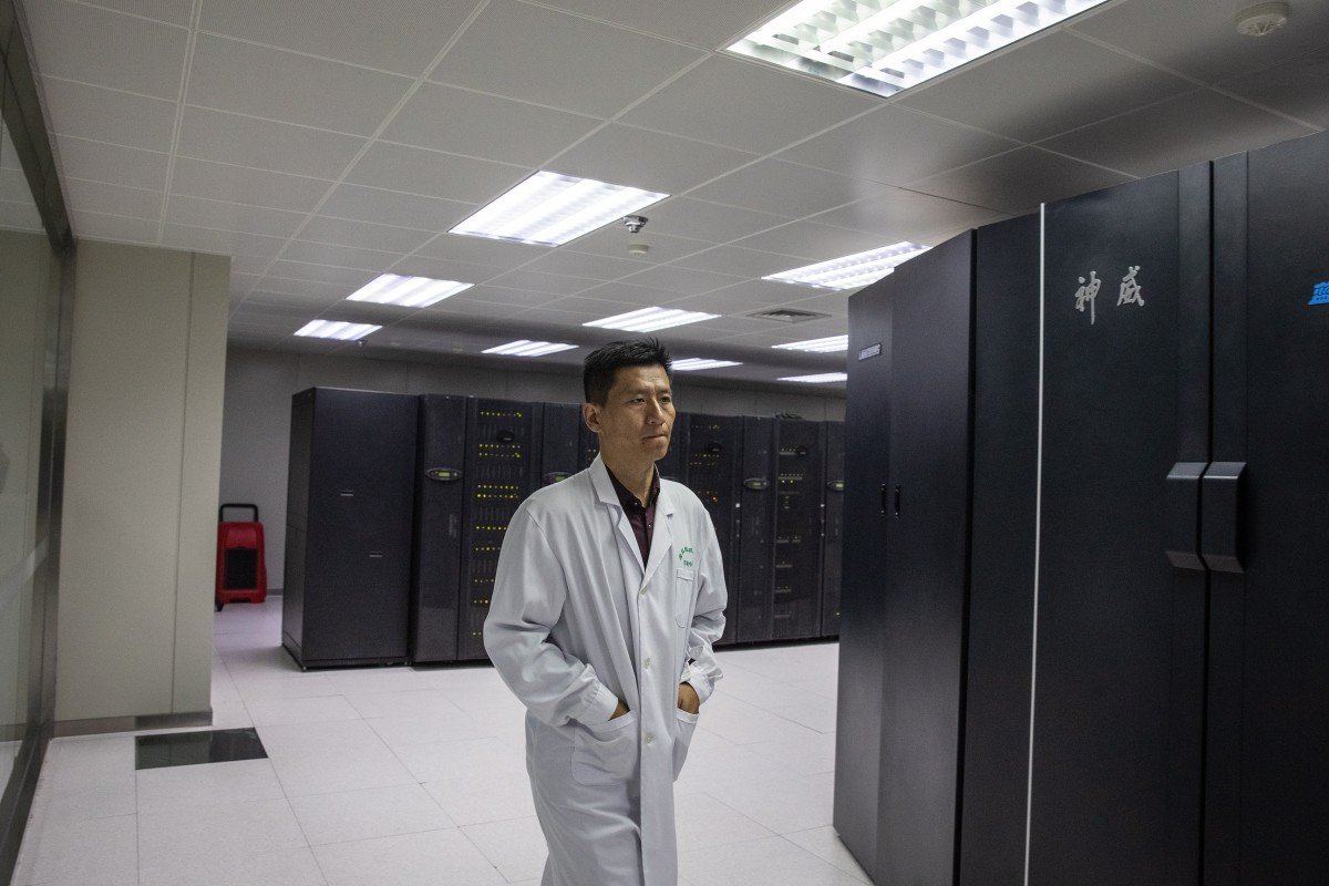 An employee walks next to supercomputers at The National Supercomputer Centre in Jinan, Shandong province. Photo: EPA-EFE