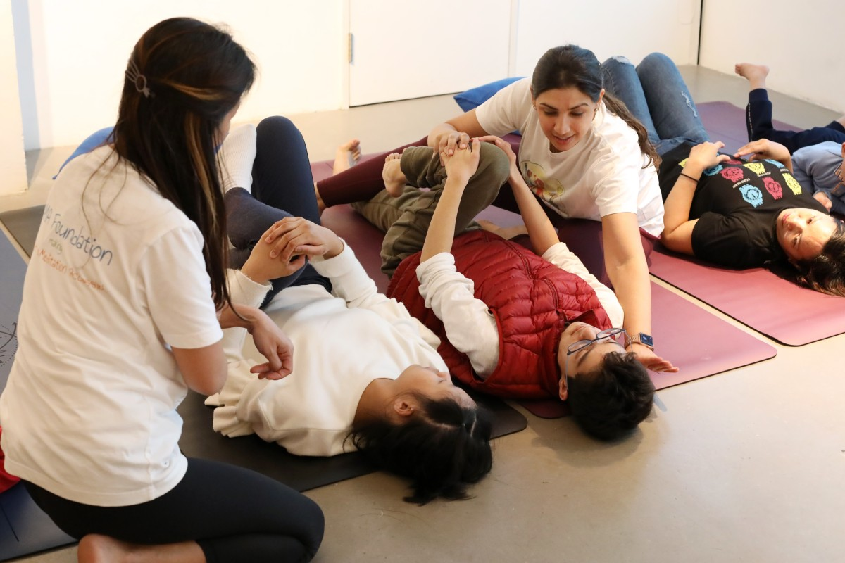 Hersha Chellaram (fourth from left), co-founder of Yama Foundation, teaching a yoga class in Sai Ying Pun. Photo: K.Y. Cheng