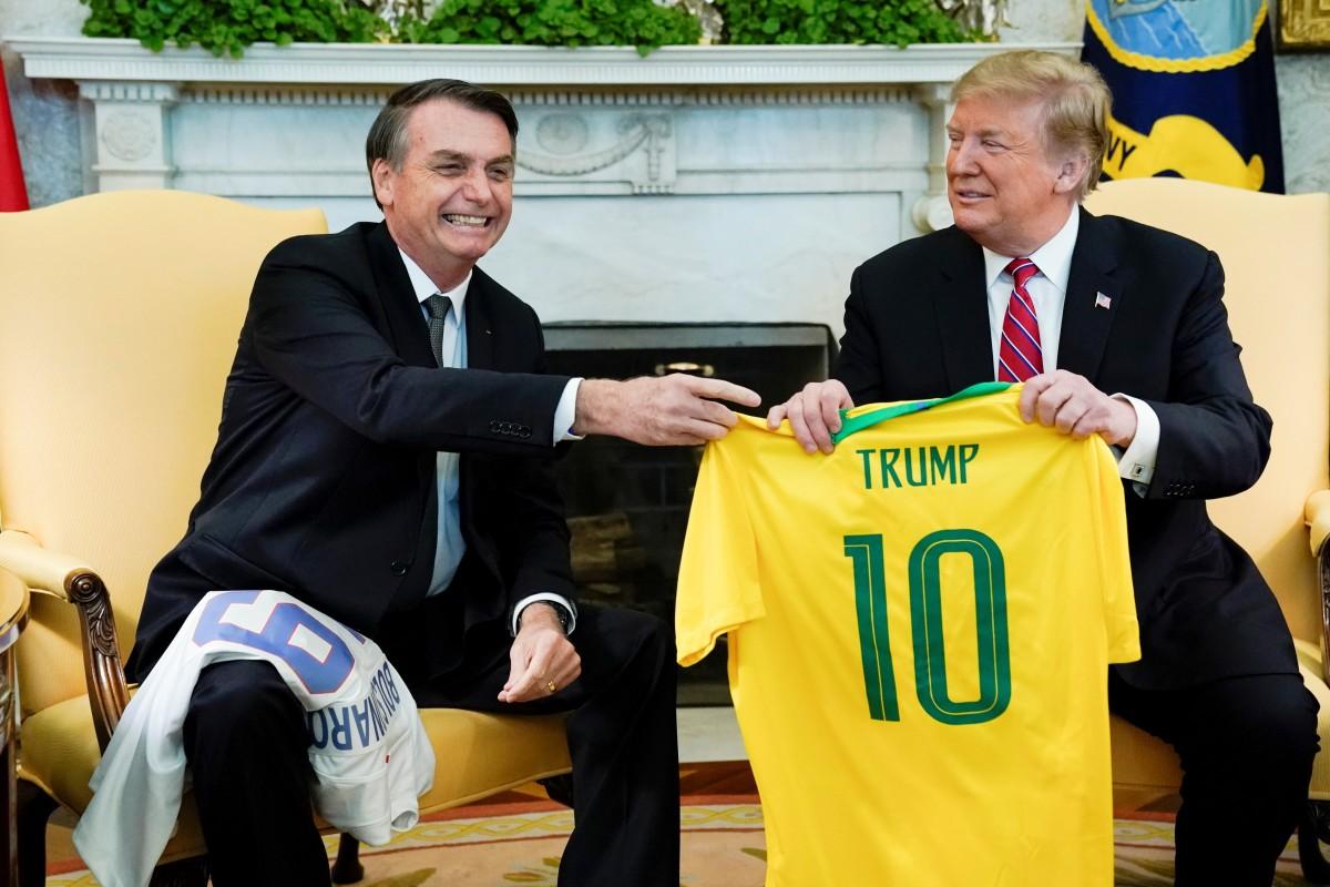 1f4e973e4 Brazil s President Jair Bolsonaro presents a Brazil national soccer team  jersey to US President Donald Trump