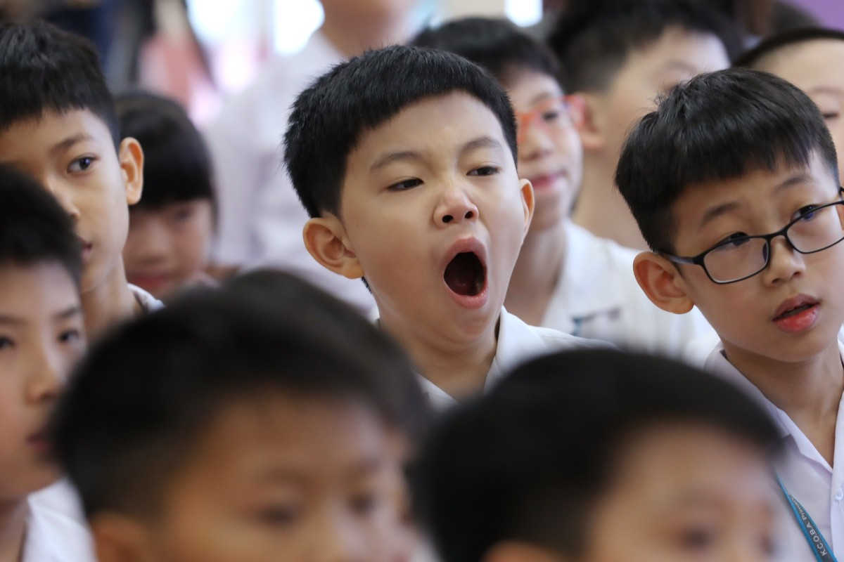 090aa5bd60a A student at a Hong Kong school yawns on the first day of the scholastic  year