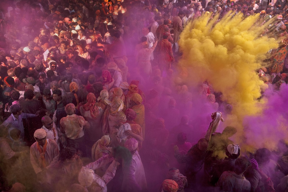 f81e5651d Indians covered in colourful powder as they pray at the Radha Rani Temple in  Barsana