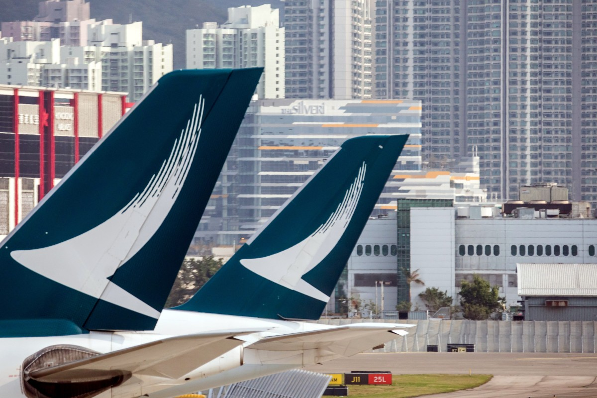b18ef52ee401 The Cathay Pacific logo on the tails of passenger planes at Hong Kong  International Airport.