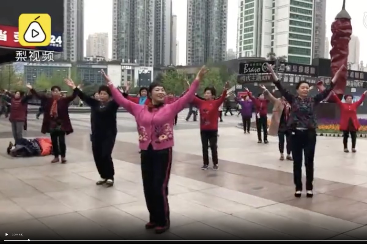 fb3214db9 A shot from the video of a group of women in Chongqing dancing while  listening to