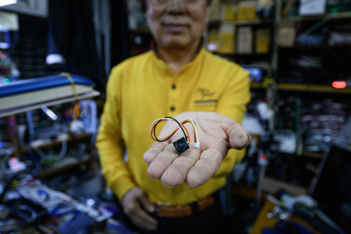 Lee Seung-yon holds a mini camera unit capable of being built into  customised devices