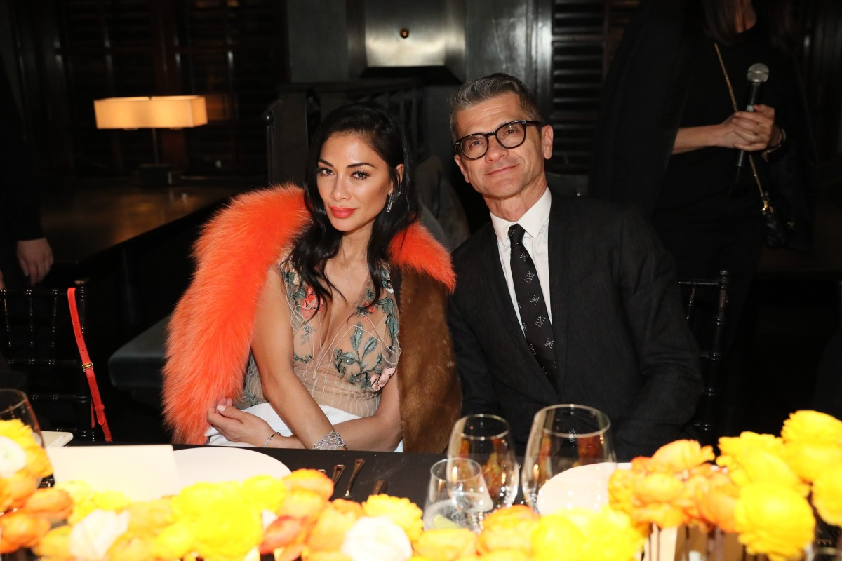 58851ca0dc95 Fendi chairman and CEO Serge Brunschwig with singer Nicole Scherzinger at a  dinner during Art Basel