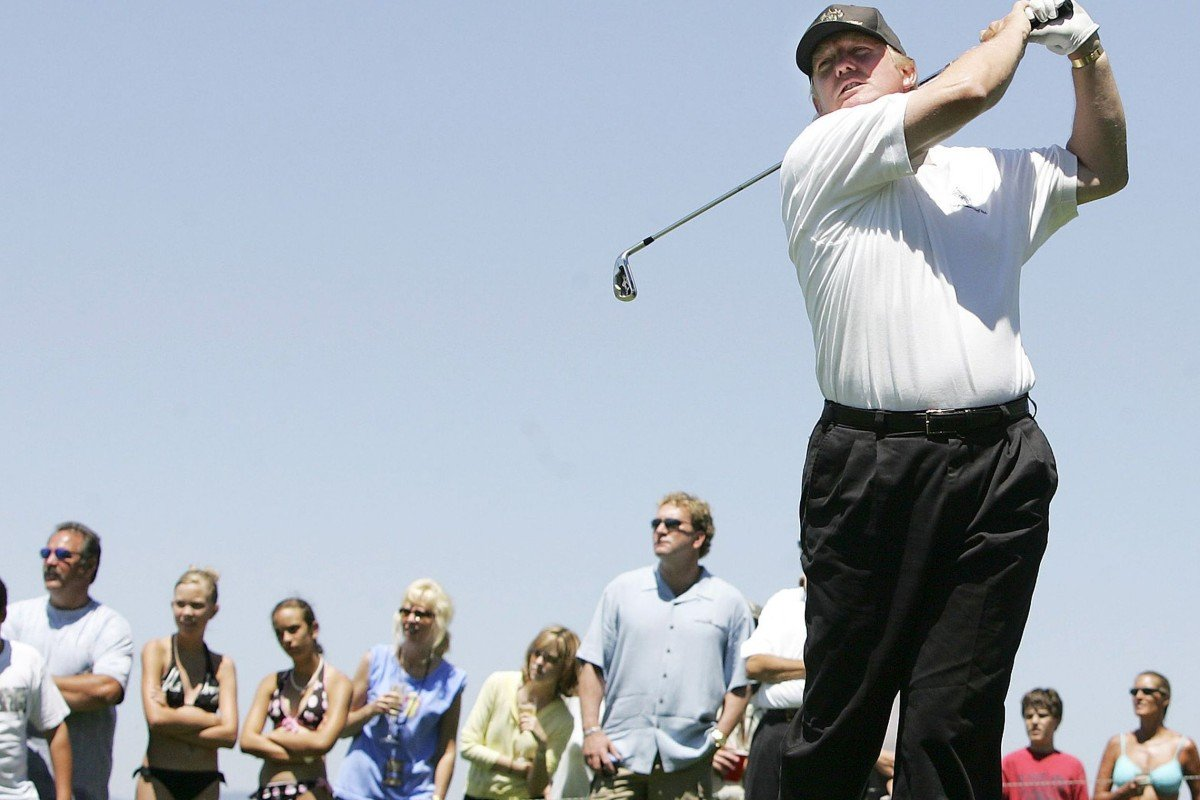 54dcef185a US President Donald Trump shows off his form at his golf course in Jupiter,  Florida