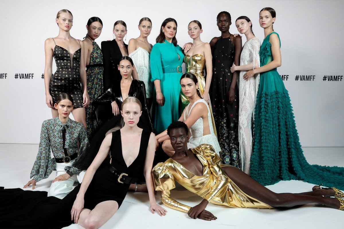 1c1e35df02 Models, including Ashley Graham (centre in aqua green dress), at the recent