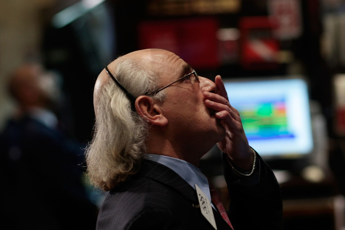 8e81d9f50fd A financial professional reacts to market volatility on the floor of the  New York Stock Exchange