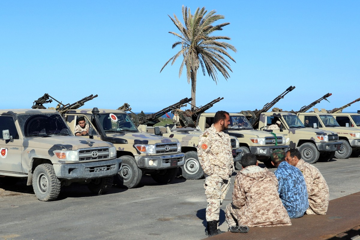 Shelling and gunfire at Tripoli airport as Libyan forces loyal to army commander Khalifa Hifter clash with...
