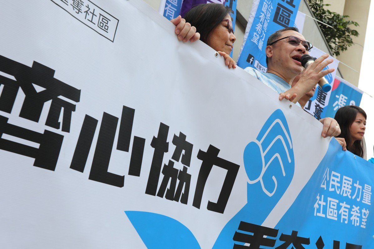 Benny Tai (with microphone) and other activists at a rally in Tung Chung on Sunday. Photo: Felix Wong