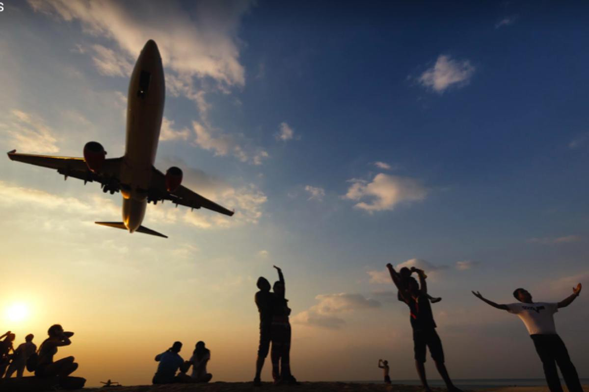 Tourists in Thailand taking Phuket airport runway selfies