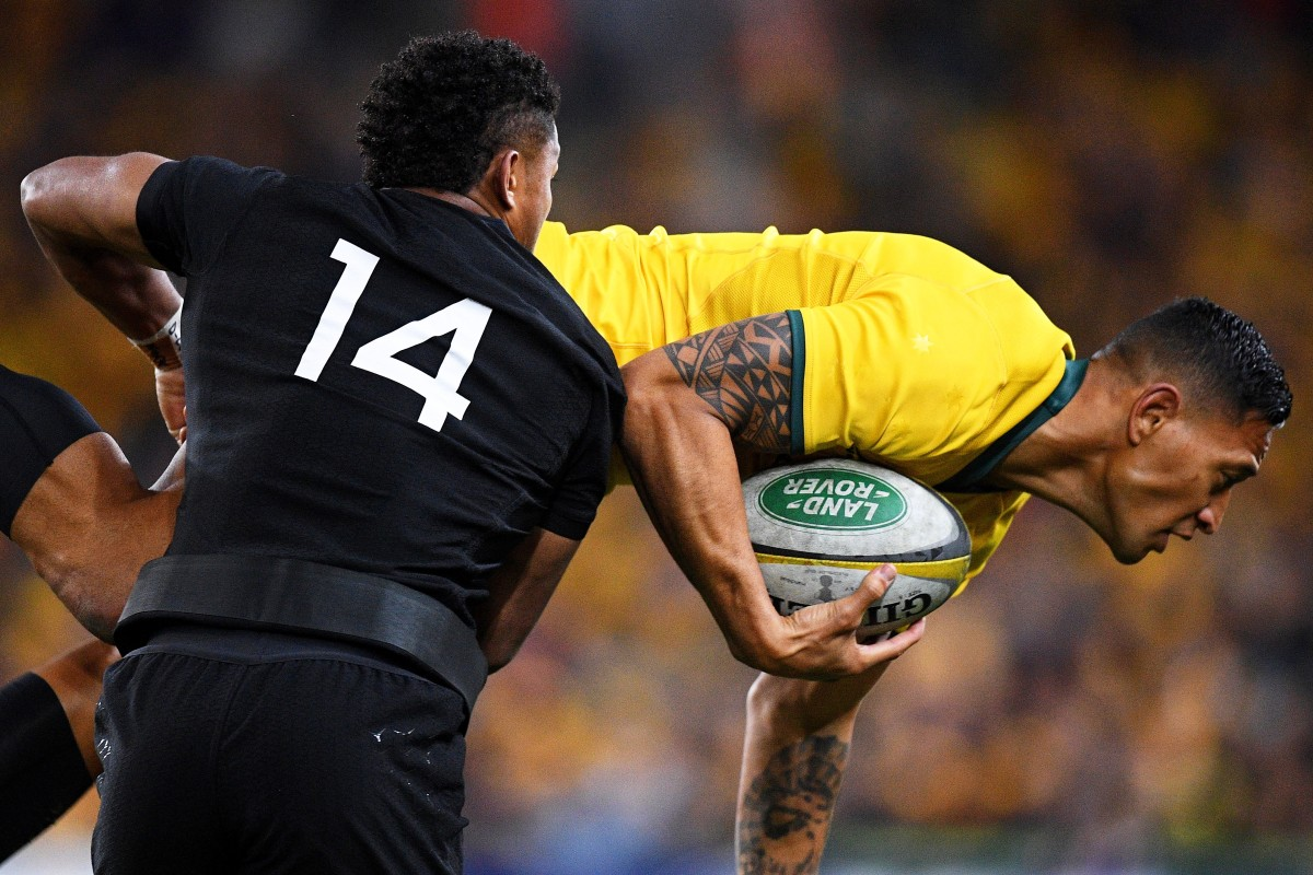 7a32597ebcd Israel Folau is tackled by Waisake Naholo. He has had his contract  terminated by Rugby