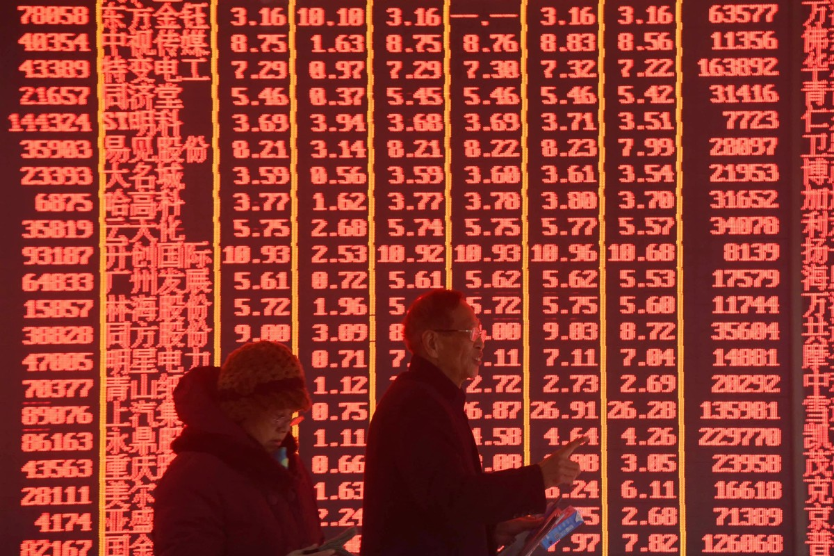 143322a290c977 Investors are seen at a stock exchange in Hangzhou