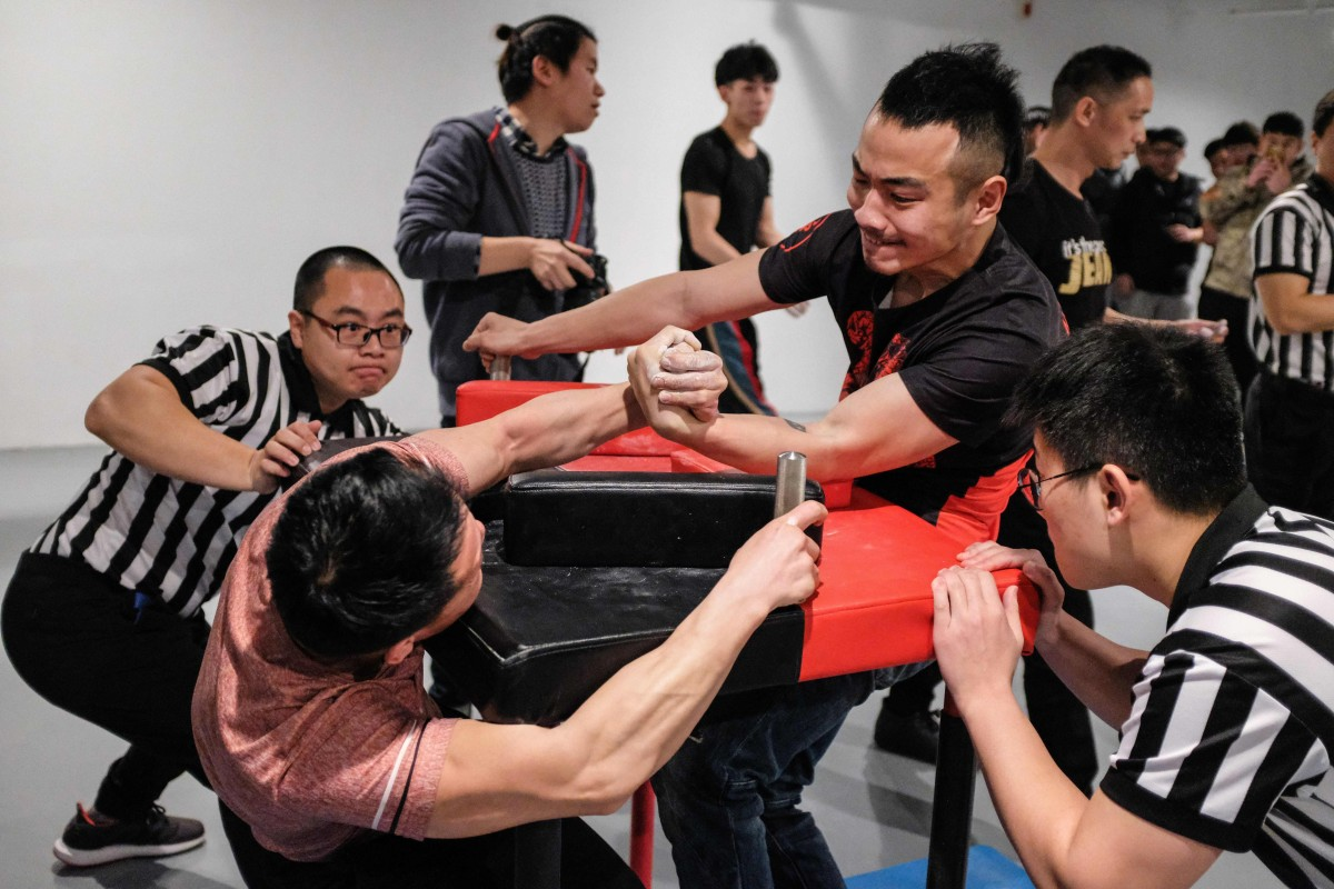 Arm wrestling in China proving gripping stuff as competitors