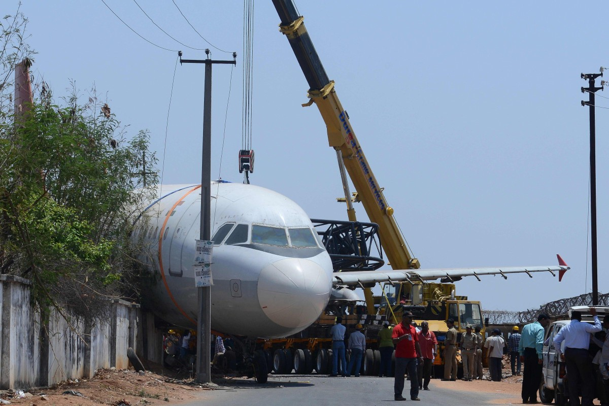 befb0a0f085fc A disused Air India passenger plane which fell from a ground transporter  while being moved near