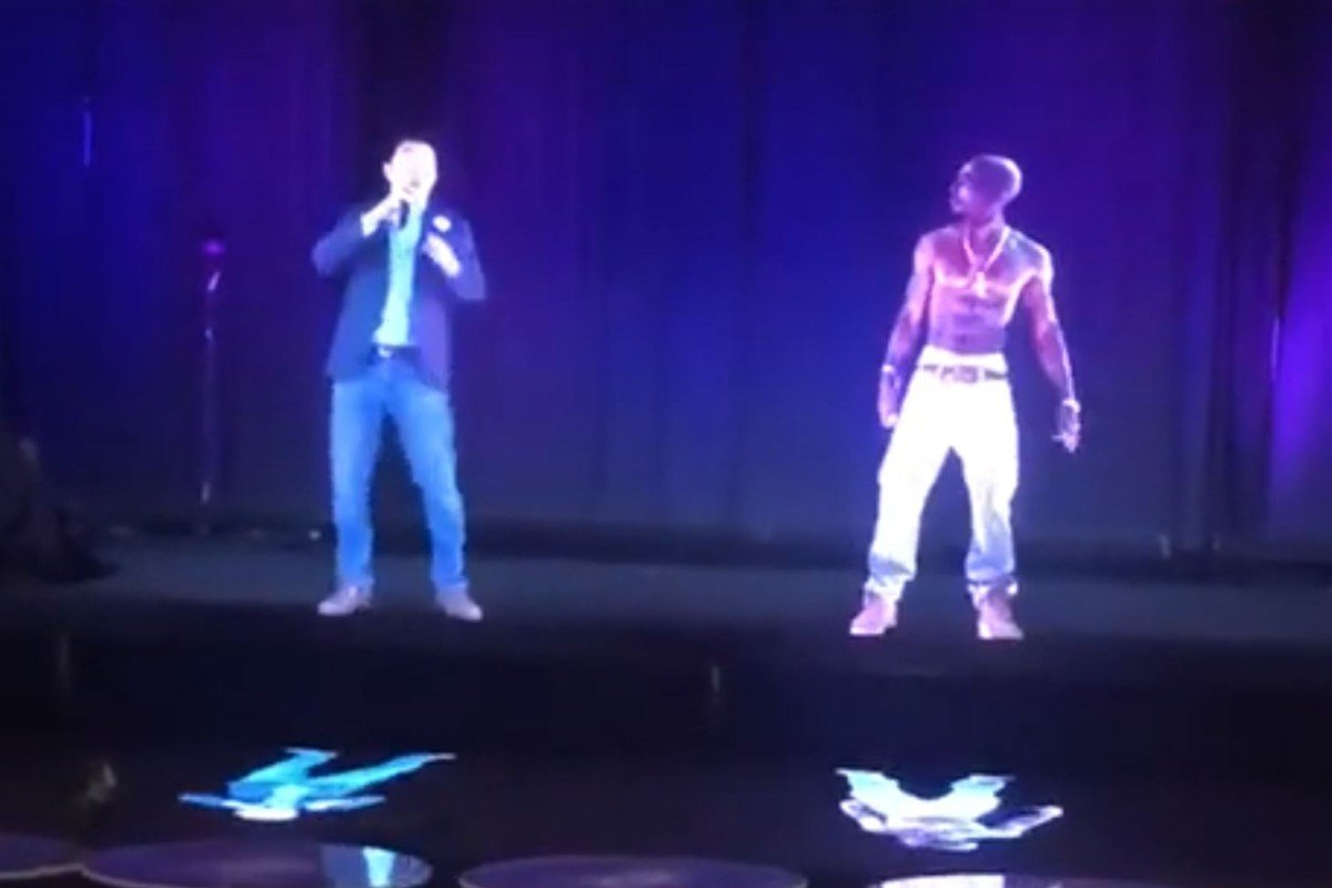 US presidential candidate Andrew Yang gets help from hologram of