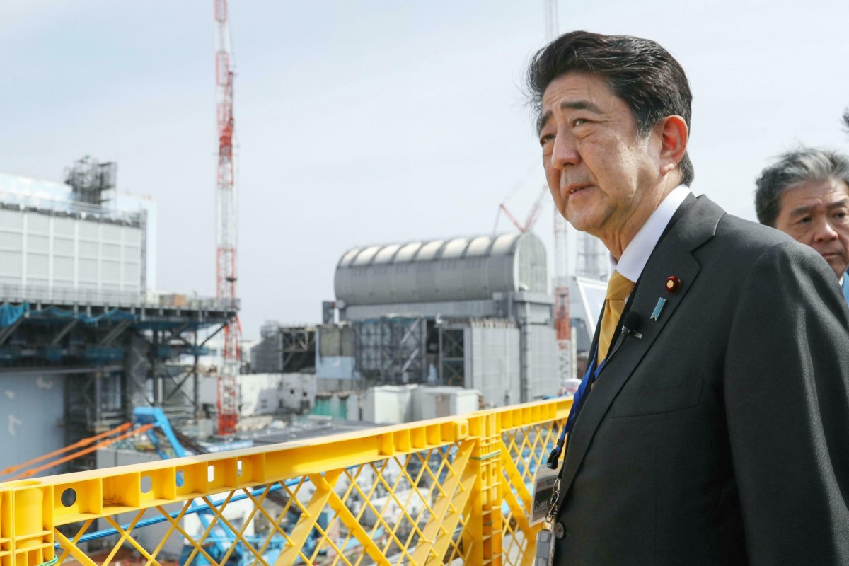Japan PM Shinzo Abe tours Fukushima to check areas affected by 2011
