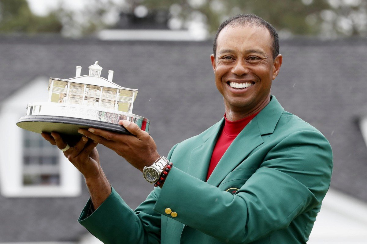 3a121279 Tiger Woods wields the Masters trophy after his win. Photo: Kyodo