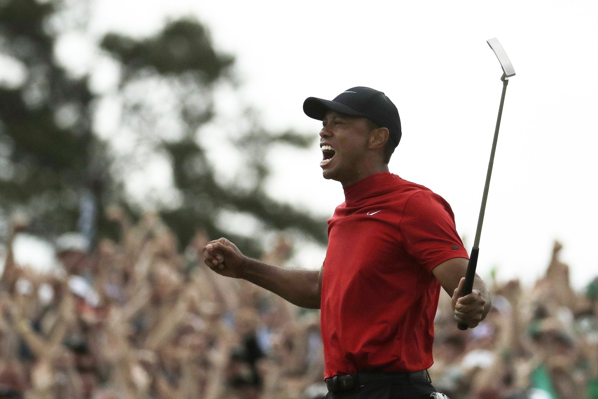 9bece310 Tiger Woods reacts as he wins the Masters golf tournament Sunday, April 14.  Photo
