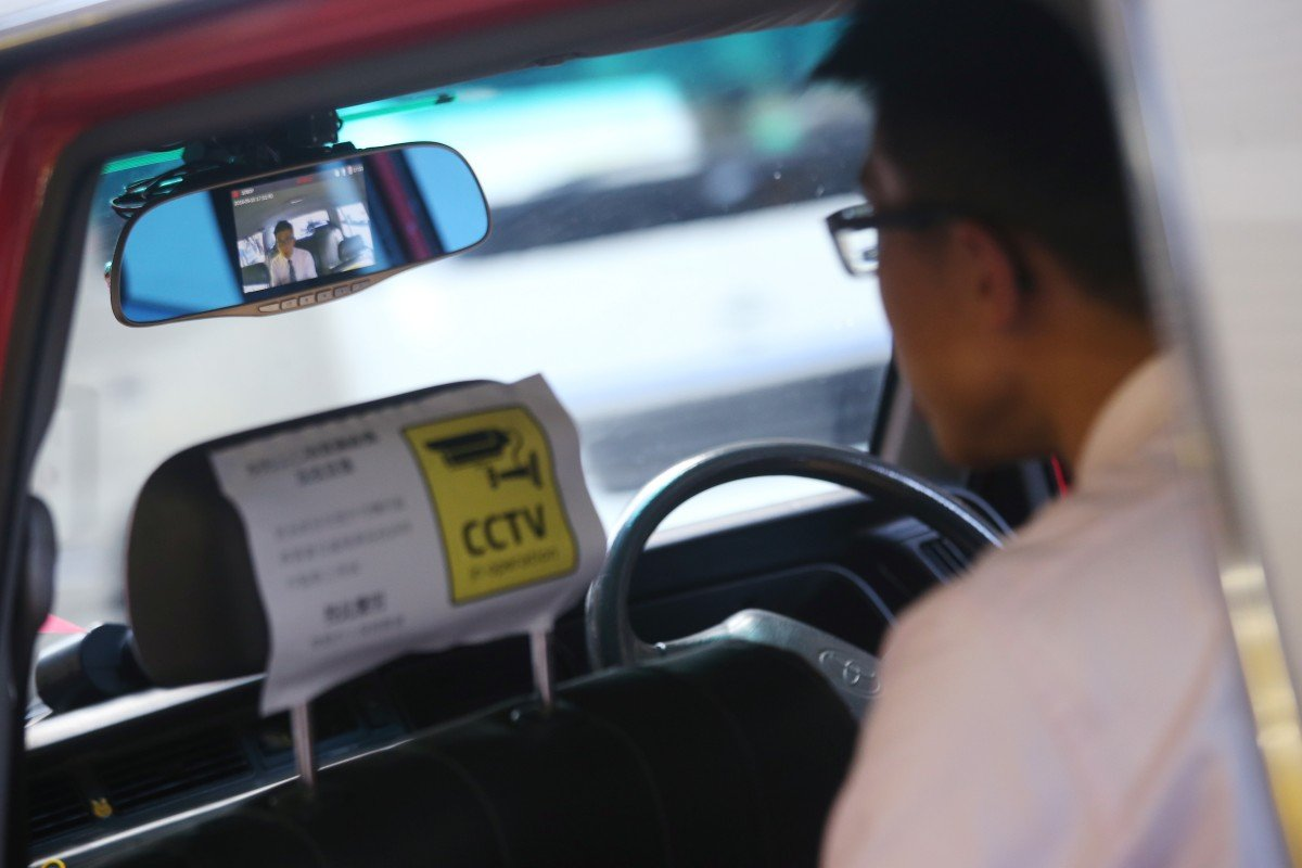 A sticker alerts passengers to an on board camera installed in a taxi as part