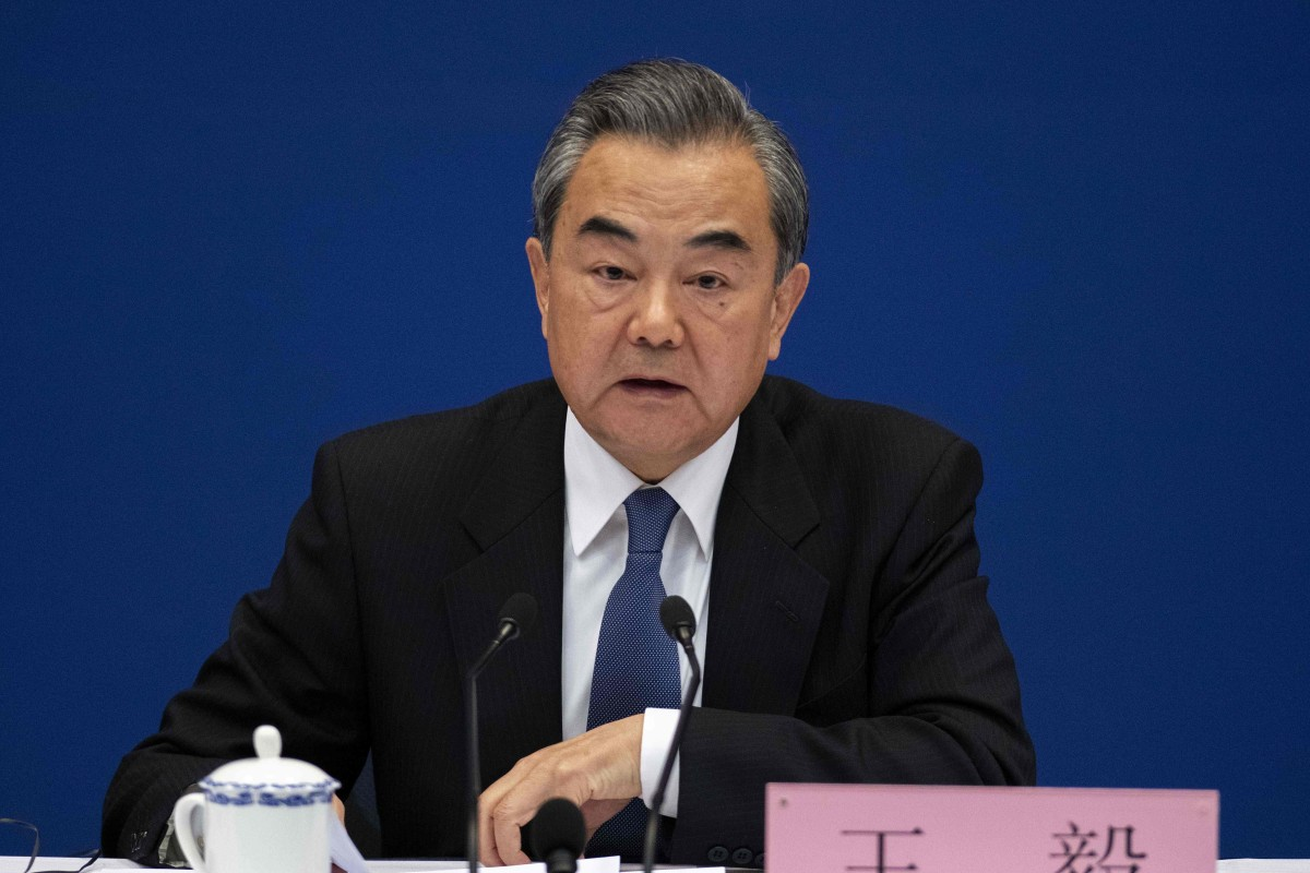 China's Foreign Minister Wang Yi appealed to nations to cooperate on the belt and road plan, not just criticise it. Photo: AFP