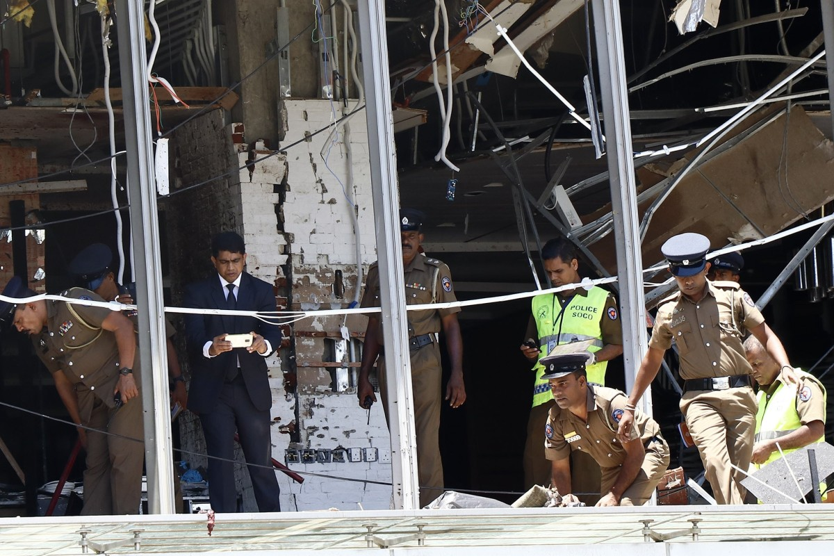 Police and investigators work at the Shangri-La Hotel blast scene in Colombo on Sunday, where the two Chinese were killed. Photo: Xinhua