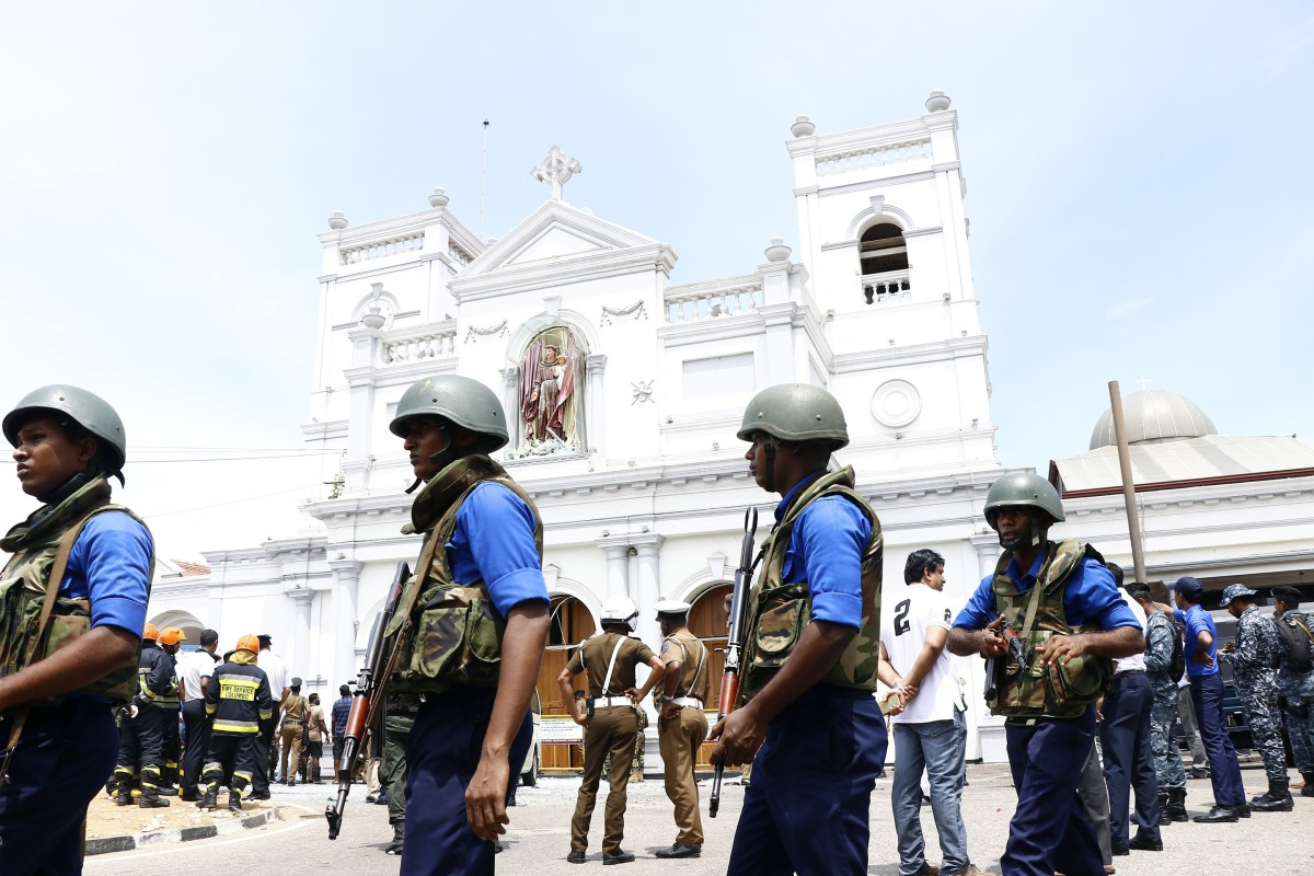 Security staff stand guard outside St. Anthony's Church where a blast took place in Colombo, Sri Lanka. Photo: Xinhua