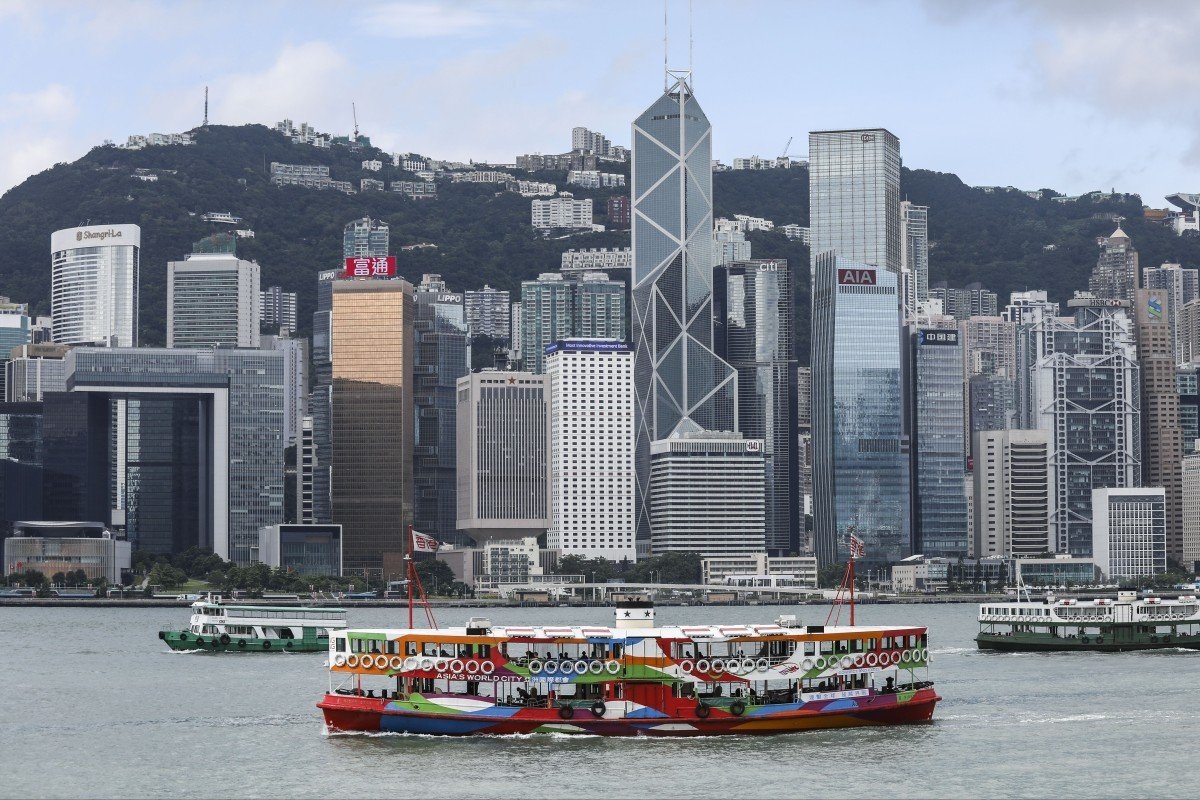 c5a4d17d204364 Hong Kong's iconic Star Ferry vessels sail across Victoria Harbour in front  of the financial district