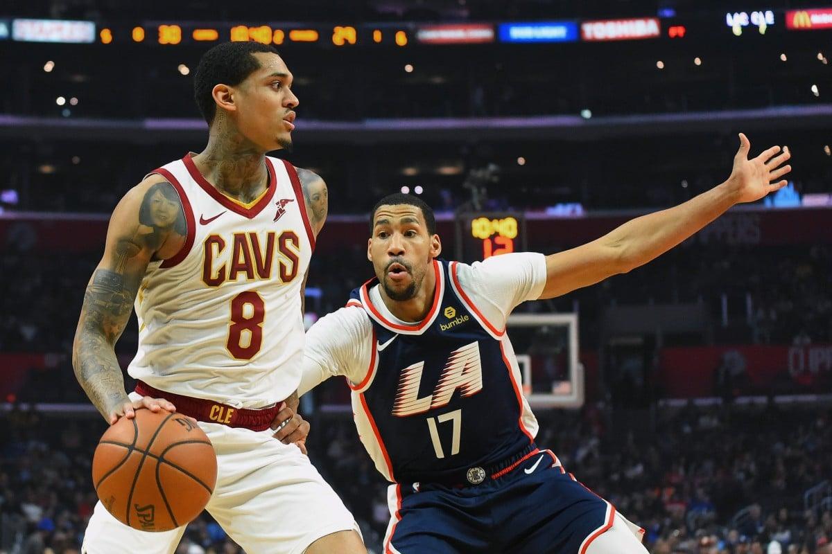 0392f1e7f92 Jordan Clarkson (left) takes on Los Angeles Clippers  Garrett Temple at  Staples Centre