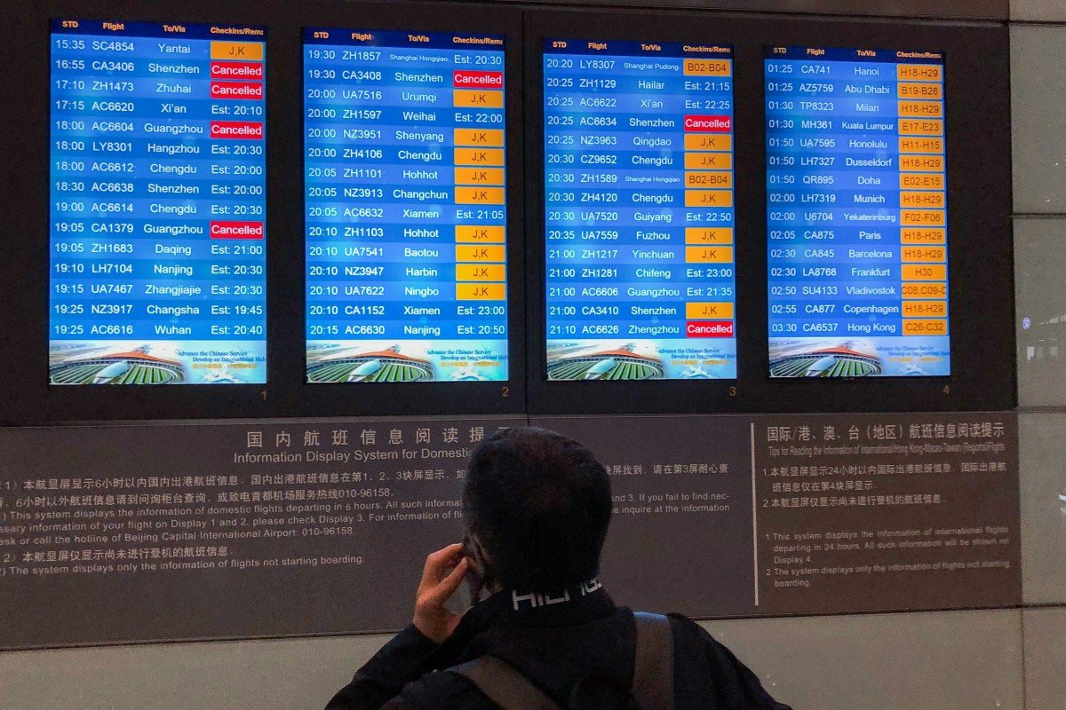 Passengers wait it out at Beijing airport as flights delayed