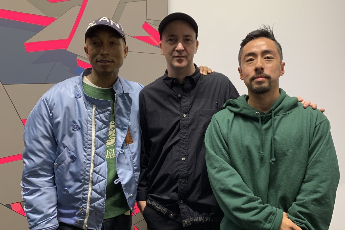 f242eb5577822 Singer Pharrell Williams (left) and collector Kevin Poon (right) with Brian  Donnelly
