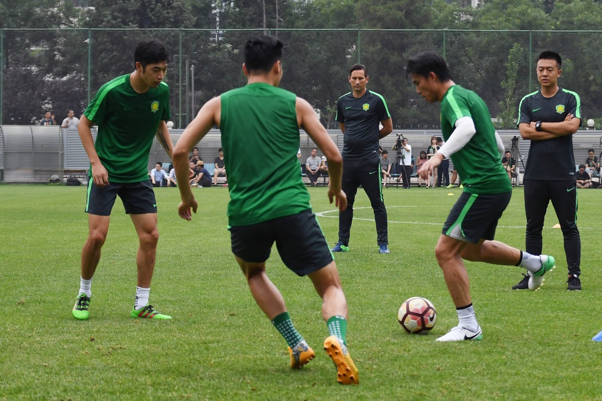 7469eb272ce Beijing Guoan coach Roger Schmidt (centre) has been in charge of the league  leaders
