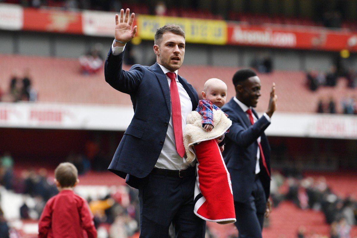 5372a971ad1 Arsenal's Aaron Ramsey joins a lap of honour as he prepares to leave the  club for