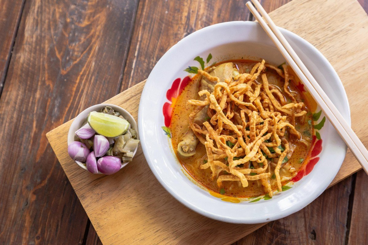 9d0251c9f347 Curried noodle soup with chicken meat and spicy coconut milk is popular in  Chiang Mai.