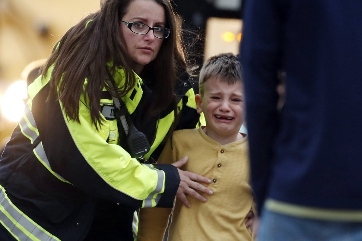 'He pulled a pistol out of a guitar case': two arrested for US school shooting that killed one, wounded...