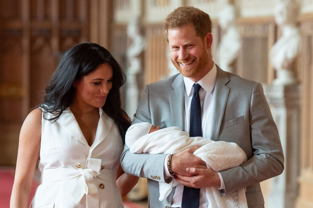 Britains prince harry and meghan duchess of sussex hold their baby son photo