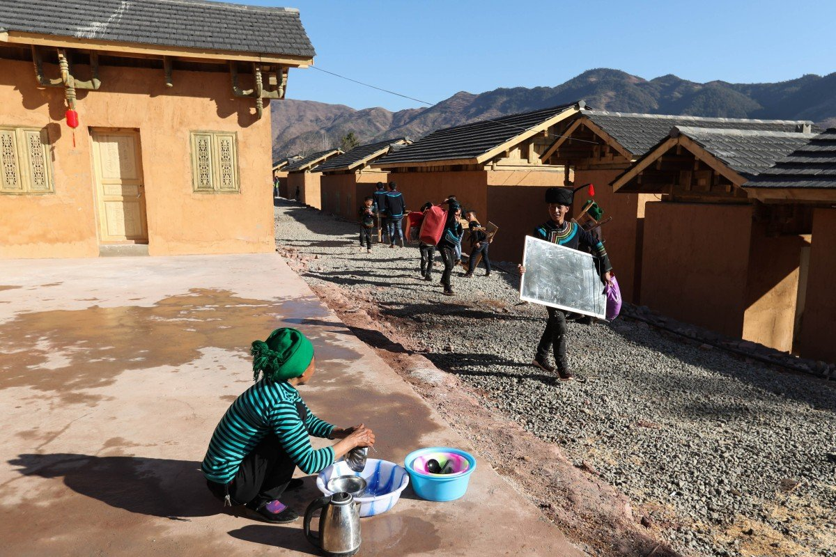 Villagers of the Yi ethnic group move into new houses for relocated residents from poor areas, in Zhaojue county in southwest China's Sichuan province. Under President Xi Jinping, China has set the goal of eliminating poverty by 2020, but the state of the rural poor in remote counties may make the task difficult. Photo: Xinhua